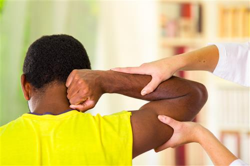 Adult Receiving Osteopathic Treatment